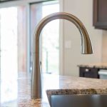 elegant kitchen faucet in luxury home