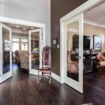 luxury custom home features french doors and wood flooring