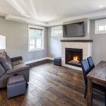 living room renovation features gas fireplace